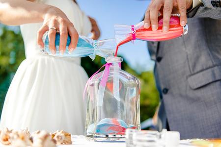 Newlyweds during sand ceremony photo
