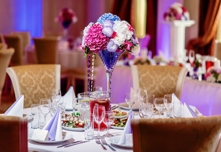 wedding table decor: Luxury banquet table setting at restaurant