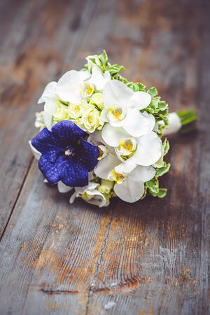 bridal bouquet: Beautiful bridal bouquet with orchids and roses