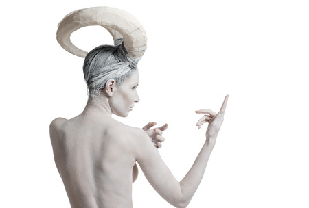bodyart: Woman with goat body-art, isolated on white . Chinese Horoscope 2015 - Year of the Goat (Sheep)