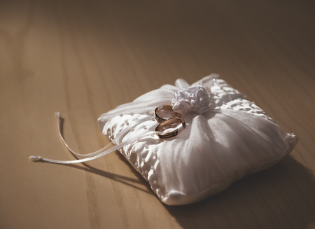wedlock: Golden rings on a white pillow