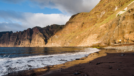Cliffs of Los Gigantes at sunset, Los Gigantes is a resort town in the Santiago del Teide. Canary Island, Tenerife. Spain photo