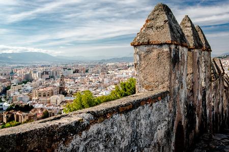alcazaba: Part of Gibralfaro fortress (Alcazaba de Malaga) and view of Malaga city. Spain Editorial
