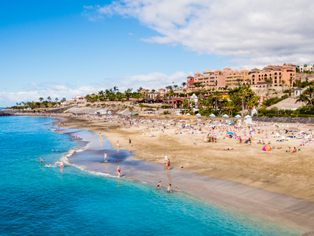 adeje: Picturesque El Duque beach in Costa Adeje. Tenerife. Canary islands, Spain Stock Photo
