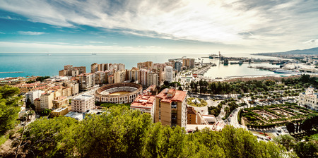 view of Malaga bullring (La Malagueta) and seaport in Spain photo