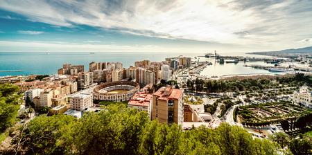 view of Malaga bullring (La Malagueta) and seaport in Spain photo
