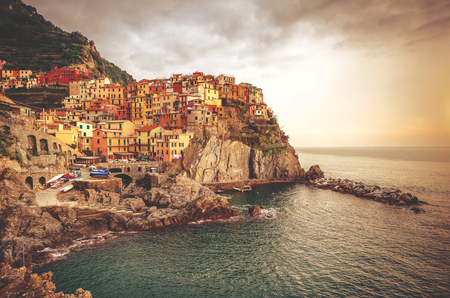 View of picturesque Manarola at sunset. Manarola is a small town in the province of La Spezia, Liguria, northern Italy. photo