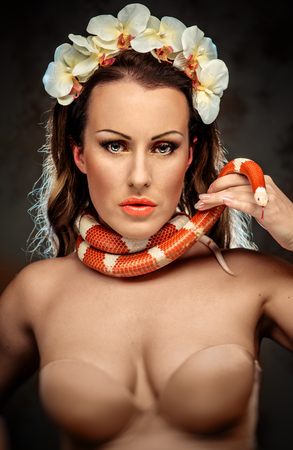 Beautiful sexy woman with snake photo
