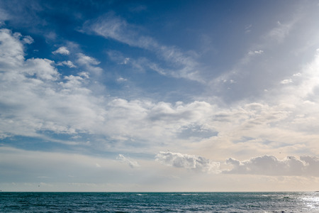 horizon: Bright cloudy sky and horizon over the sea Stock Photo