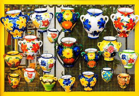 souvenir traditional: Colorful ceramic pots in Mijas, Andalusian town on the Costa del Sol. Spain Stock Photo