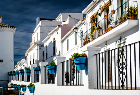 spanish houses: Typical spanish white village houses with flower pots. Andalusian Costa del Sol. Southern Spain