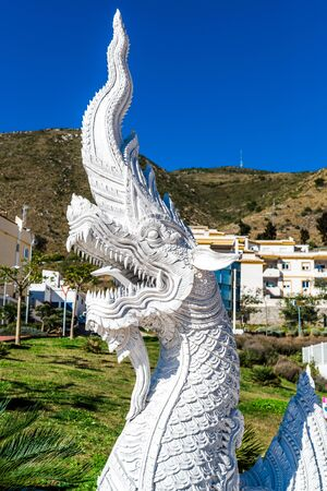 winged dragon: Benalmadena Spain January 6 2014: Dragon sculpture at the Butterfly Park in Benalmadena. The biggest butterfly park in Europe it has over 1500 of the colorful little winged insects. Andalusia southern Spain Editorial