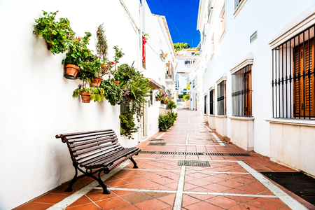 Picturesque narrow street of Rancho Domingo. Charming white village in Benalmadena. Andalusia southern Spain photo