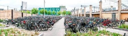 parking station: Eindhoven Netherlands  May 23 2015: Panorama of Bicycle parking area in Eindhoven Central Station. Bicycles are popular way to get around for the Dutch