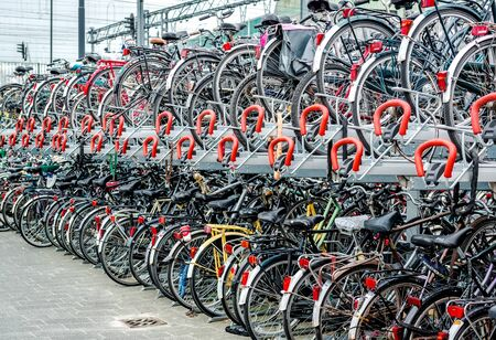 parking station: Eindhoven Netherlands  May 23 2015: Bicycle parking in Eindhoven Central Station. Bicycles are popular way to get around for the Dutch Editorial