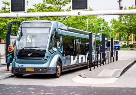 recharging: Eindhoven Netherlands  May 23 2015: Bus rapid transit Phileas in Eindhoven Central Station. The biggest feature of the bus is the recharging of the battery by means of electromagnetic induction