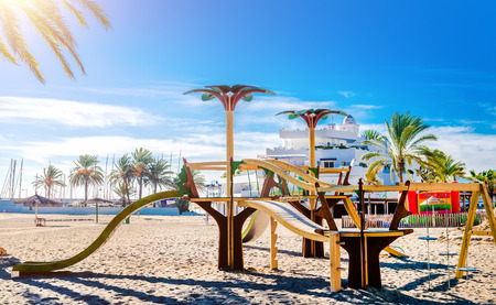 Children playground on the sunny tropical beach photo