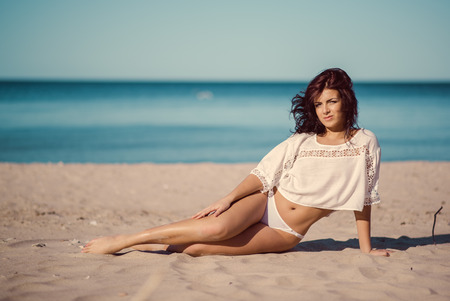 sea beach: Young woman relaxing on the beach near the sea