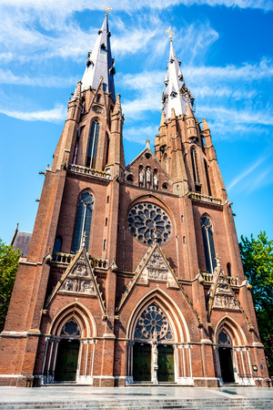 gothic revival: Facade of roman catholic Saint Catharine Church Catharinakerk in Eindhoven Netherlands. Church in Gothic Revival style.