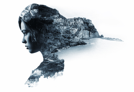 people: Double exposure portrait of a woman and view of Manarola. La Spezia, Liguria, northern Italy. Black and white image Stock Photo