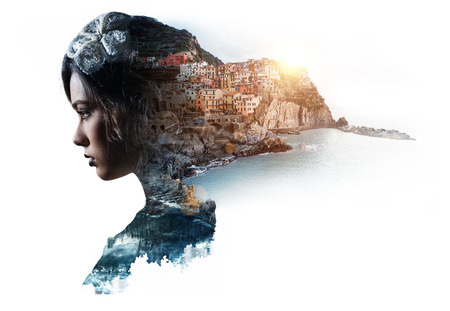 Double exposure portrait of a woman and view of Manarola. La Spezia, Liguria, northern Italy. Toned image Imagens