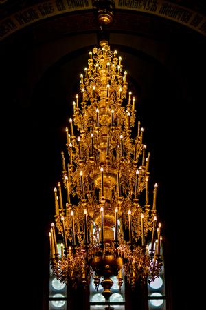 indoors: Luxurious huge golden chandelier indoors