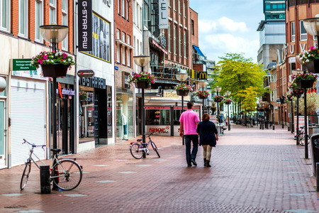 main street: Eindhoven, Netherlands - May 24, 2015: People walking in the Eindhoven main commercial street. It is one of the most famous shopping street in the city, a narrow but long street with plenty of stores, bars and clubs