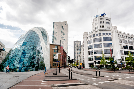 Eindhoven, Netherlands - May 24, 2015: Day view of the old Philips factory building and modern futuristic architecture in the city centre of Eindhoven. Western Europe