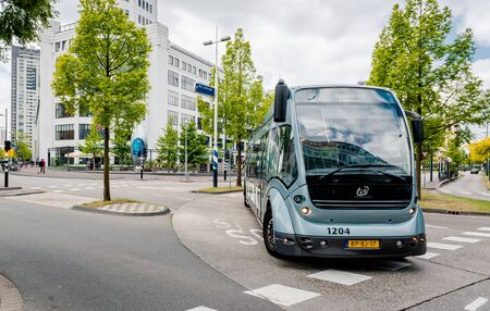eindhoven: Eindhoven, Netherlands - May 24, 2015: Bus rapid transit Phileas on the Eindhoven road. The biggest feature of the bus is the recharging of the battery by means of electromagnetic induction