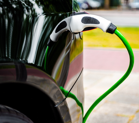 voltage: Electric car charging in EV charging station