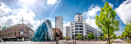 futuristic city: Eindhoven, Netherlands - May 24, 2015: Panoramic view of the old Philips factory building and modern futuristic architecture in the city centre of Eindhoven. Western Europe