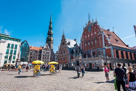 Riga, Latvia- August 20, 2015: Day view of the Town Hall Square and the Blackheads House. The building of the Brotherhood of Blackheads is one of the most iconic buildings of Old Riga. This is almost certainly the most famous building in Riga and one whic