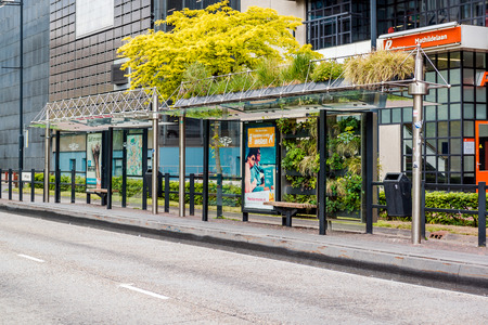 eindhoven: Eindhoven, Netherlands- May 24, 2015: Eindhoven green bus stop. The green bus stop was created as part of a competition organized by the Municipality of Eindhoven back in 2009. The bus station was featured during 2009 Dutch Design Week Editorial