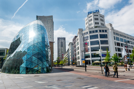 city square: Eindhoven, Netherlands - May 24, 2015: Day view of the old Philips factory building and modern futuristic building in the city centre of Eindhoven. Western Europe Editorial