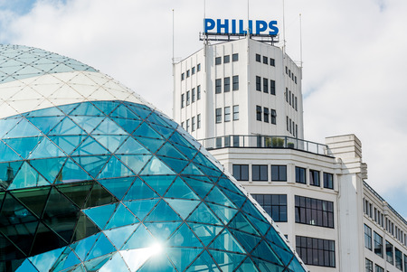 philips: Eindhoven, Netherlands - May 24, 2015: Day view of the old Philips factory building and modern futuristic building in the city centre of Eindhoven. Western Europe Editorial