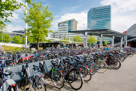 parking station: Eindhoven, Netherlands - May 24, 2015: Bicycle parking area in Eindhoven bus central station. Bicycles are popular way to get around for the Dutch Editorial