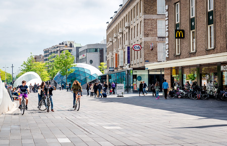 eindhoven: Eindhoven, Netherlands - May 24, 2015: People walking in the Eindhoven square. It is one of the most famous place in the city with plenty of restaurants, shopping centres, bars, stores and clubs