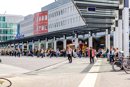 eindhoven: Eindhoven, Netherlands- May 24, 2015:Crowd of people in Eindhoven railway station. The station was opened on 1 July 1866 Editorial