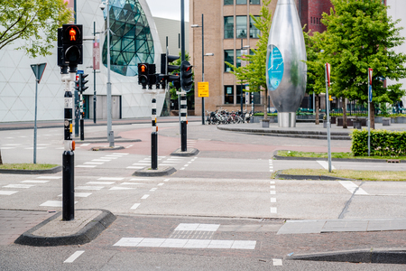 eindhoven: Eindhoven, Netherlands- May 24, 2015: Day view of a Eindhoven empty road. Bicycles are popular way to get around for the Dutch. Eindhoven is one of the five nominees to become best Cycling City of the Netherlands in 2014