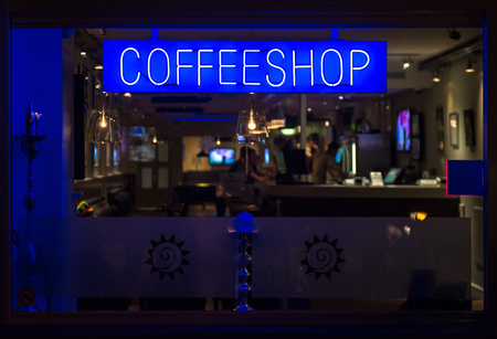 shop sign: Coffeeshop neon signboard at night. Eindhoven, Netherlands