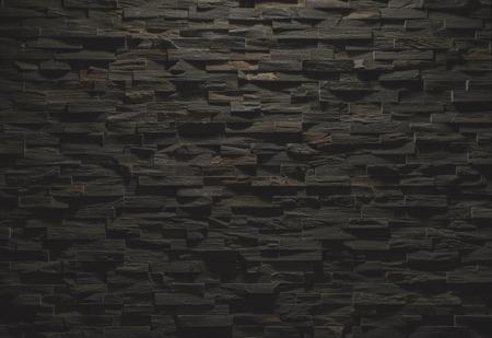 黒い石造りの壁のテクスチャ