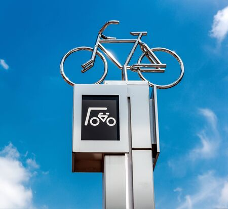 eindhoven: Bicycle parking sign against blue sky background. Eindhoven city center. Netherlands Stock Photo