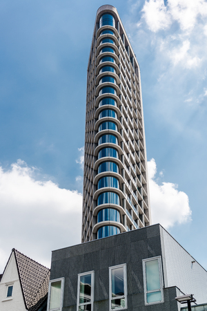 eindhoven: Eindhoven, Netherlands - May 24, 2015: Day view of The Vesteda tower. Located in Eindhoven and was finished in 2006, it is the fourth highest building in Eindhoven Editorial