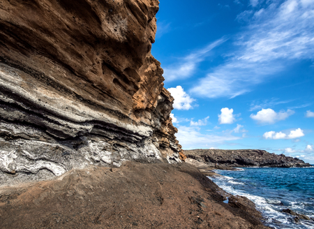 stone volcanic stones: Picturesque Yellow Mountain Montana Amarilla in Costa del Silencio. Tenerife, Canary Islands
