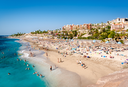 Tenerife, Canary Islands- January 1, 2015: People sunbathing in the picturesque El Duque beach, Tenerife. Canary islands, Spain