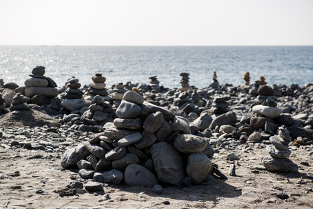 sculpture: Art of stone balance, piles of stones on the beach. Tenerife, Canary Islands. Spain Stock Photo