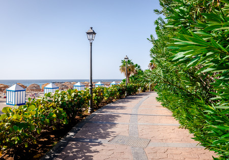 seafront: Seafront promenade along El Duque beach. Tenerife, Canary Islands. Spain Stock Photo