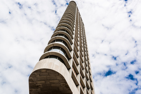 eindhoven: Eindhoven, Netherlands - May 26, 2015: Day view of The Vesteda tower. Located in Eindhoven and was finished in 2006, it is the fourth highest building in Eindhoven