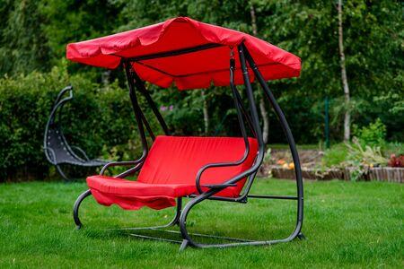 canopy: Canopy swing or garden swing in a lawn