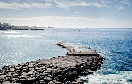 americas: Peoples fishing on the Las Americas pier. Tenerife, Canary Islands. Spain Stock Photo